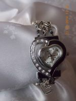 Black and silver stretch heart watch by Quested-Creations