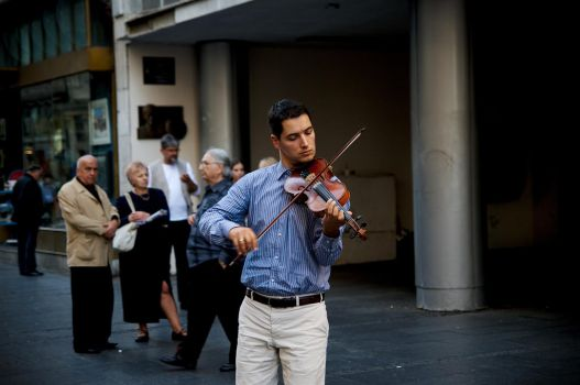 Street musician playing violin in Belgrade by aruseni