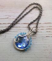 bule wire wrapped pendant by EatThatCookie