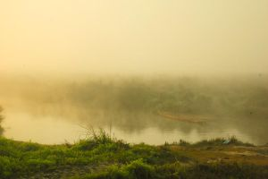 boat in the morning mist by MugdimanDhaulagiri