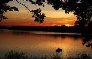 sunset at lake with an angler by Nexu4