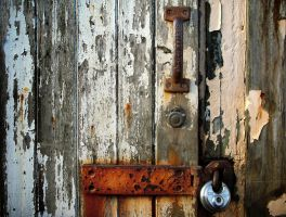 Rust pealing paint new padlock by picture-frame