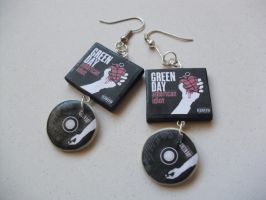 Green Day American Idiot album earrings by InsaneJellyBean95