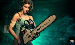 Evalena and her chainsaw. by MikePecci
