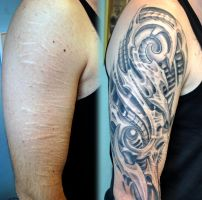 Cover scars biomech tattoo by Charlie by gettattoo
