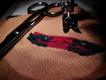 Omana family crest embroidery by tlacuilopilo
