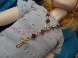 Gold and Purple Rosary by Lovekeysan