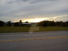 A Cloudy Sunset over a Farm by dhbraley