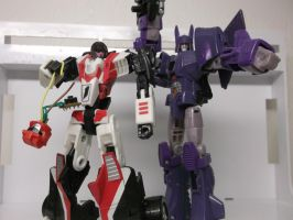 Cyclonus and Fracture united by forever-at-peace