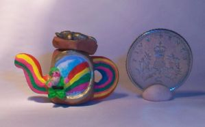 hand sculpted miniature ooak teapot of gold by quantumcreations
