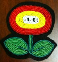 Beaded Mario fire flower by Particularlyme