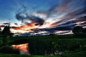 HDR Sunset over a Lake by Foxseye