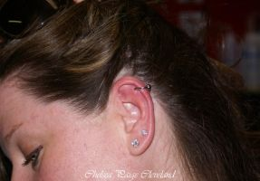 Cartilage Piercing by Chelsea Paige Cleveland by SmilinPirateTattoo