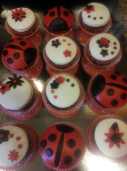 Ladybug and Flower Cupcakes by Cupcake-Killer