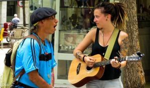 Musician and a amazed audience by shai739