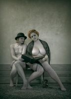 Two girls read the Bible by rockograaf