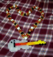 Glow-in-the-Dark Fire-Necked Guitar Necklace by cadillacphunque