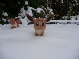 Eevee playing in the snow by dodoman75