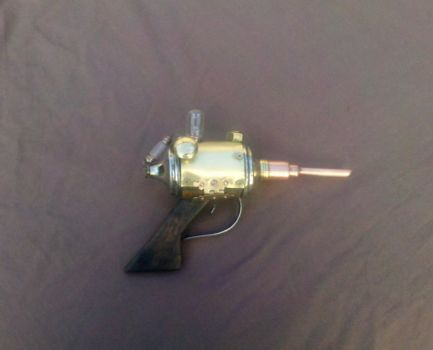 Steampunk cosplay prop: Assassin's needle pistol! by vulpinedesigns