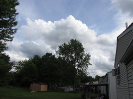 Beautiful White Clouds in the Neighborhood by TheStockWarehouse