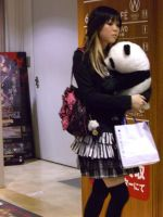 Japanese girl whit her panda by Fantasmiki