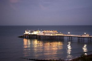cromer pier at night by alt3r3dview