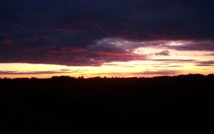 Crimson clouds sunset in MN by jimmyselix