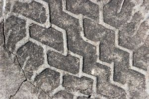 Tire Track in Concrete by GrungeTextures