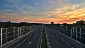 Sunset over the highway by piotrkol91