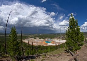 grand prismatic spring and approaching storm by eDDie-TK
