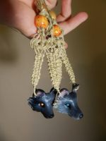 Tiana and Michaels Wolf Pendants by PoisonJARCreations