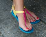 Red Toes in Colorful Rubber Sandals by Feetatjoes