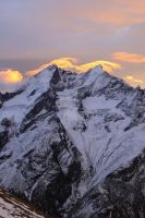 Taschhorn at sunrise, stormy weather by jaroslavnisler