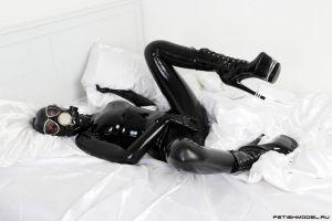 Black Latex Rubber Girl in a White Room. 24 by agnadeviphotographer