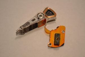 Disassembled HDD components by Gageter