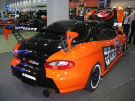 Orange and Black Tiburon Turbo by Kia-Motors