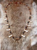 Mountain lion necklace. by Tabbicatt