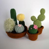 Crocheted cacti by LunasCrafts