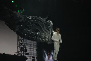 Justin Bieber coming down on wings by AnimatedSquirrel