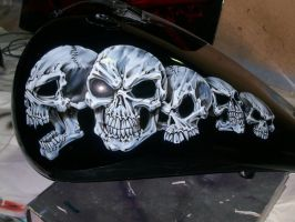 Skulls on bike tank by Evoke93