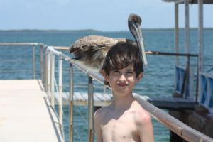 My brother and a pelican by AnnabellaTMIID