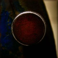 found objects: the red knob by Moon-Willow