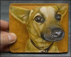 Buster on a leather wallet. by AshleyBrayson
