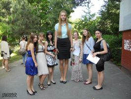 Tall girl with small classmates by lowerrider