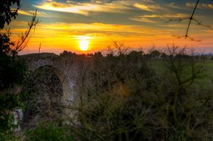 Arch and sunset by Tiris76