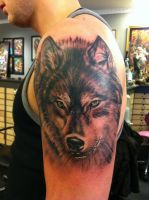 yet another wolf tattoo by jrunin