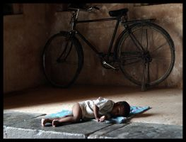 Baby and bicycle by VictorInDelhi