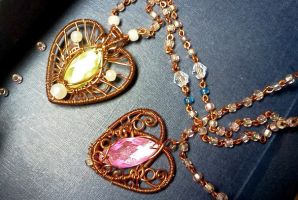 2 heart pendants by CovenEye