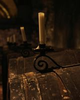 Candle on a barrel by UdoChristmann