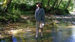 Nadia Checks the River in her Green Penny Loafers by peerlesspenny